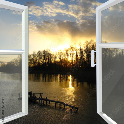 window opened to the river with sunset - 75564184