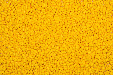 yellow polymer pellets for background