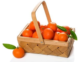 Crate of ripe tangerines with green  leaves