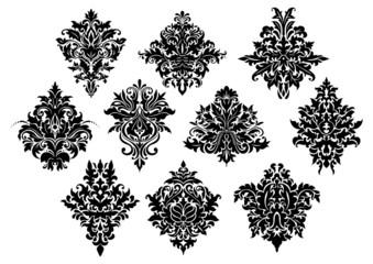 Black ornate floral motifs in damask style