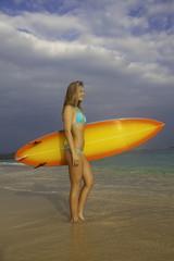 teenage girl with surfboard