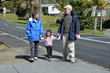 Grandparents walking with their granddaughter