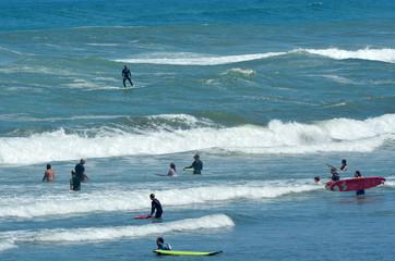Surfing in Muriwai beach - New Zealand