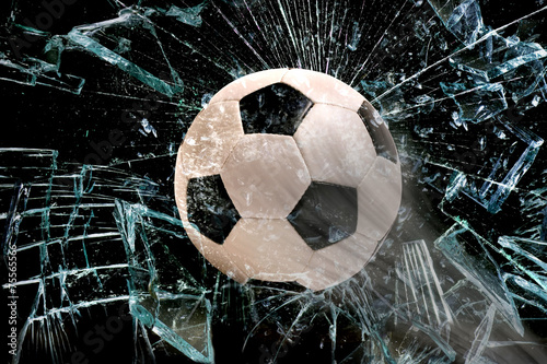 Soccer ball through glass.