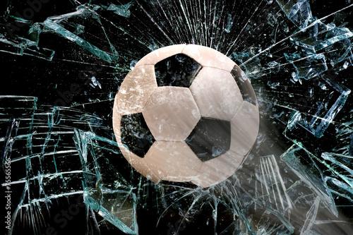 Soccer ball through glass.