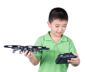 Boy holding a radio remote control for helicopter, drone, plane