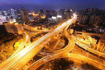 modern city traffic and skyline at night,shanghai.