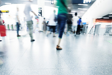 passengers walking in rush hour at subway station