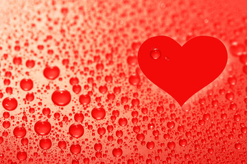 Water drops background with heart sign