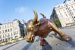 Copper Bull statue on the modern city  street of shanghai.