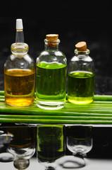 massage oil and set of green plant stem still life
