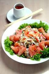 Mixed fruit, vegetable and seafood salad. Asian food.