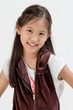 Portrait of happy little Asian child on isolated background