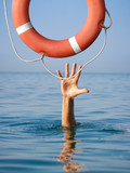 Lifebuoy for drowning man in sea or ocean water. Insurance