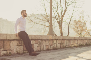 Hipster style bearded man posing outdoor