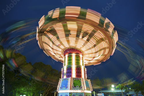 colorful carousel in motion - 75570966