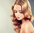 Leinwandbild Motiv Beautiful model blond with curly hair and fashion earings