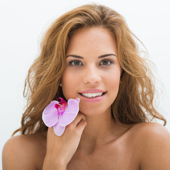 Beautiful Girl With Orchid Flowers, perfect skin