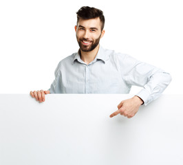 A young bearded man showing blank signboard, isolated over white