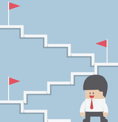 Businessman climbing on the stairway to target