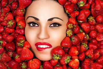beautiful seductive face of woman in strawberries
