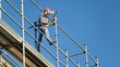 canvas print picture - Construction worker on scaffolding
