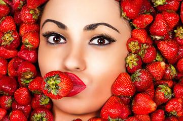 fashion beautiful face in strawberry closeup