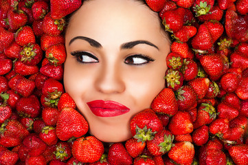 seductive woman face in strawberries
