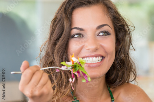 Smiling Woman On A Diet - 75576704