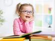 Leinwanddruck Bild - Happy kid reading books and dreaming