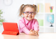 Happy kid with tablet PC in glasses as early education concept - 75577173