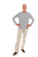 Senior man standing isolated over white background