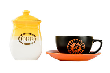 Pots of coffee and cup on a saucer, yellow-white color on a whit