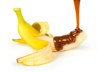 caramel is poured on a banana