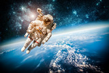 Astronaut outer spac Elements of this image furnished by NASA. - 75579113