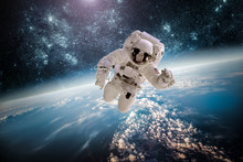 """Постер, картина, фотообои """"Astronaut outer spac Elements of this image furnished by NASA."""""""