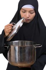 woman carries a large pot
