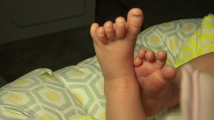 Closeup of Two Baby's Feet