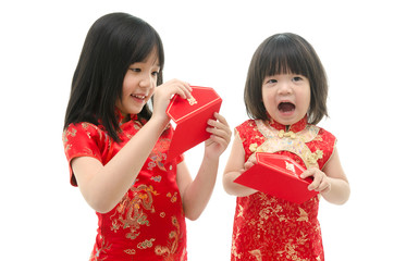 Little asian girl and boy holding red packet monetary gift