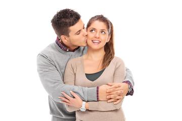 Romantic man kissing his girlfriend