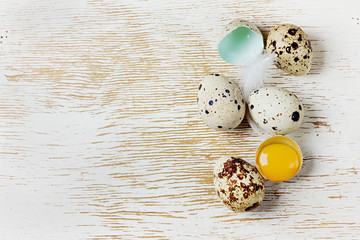 speckled quail eggs on a rustic background
