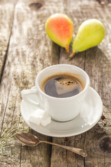 coffee cup black wooden board brown pears white