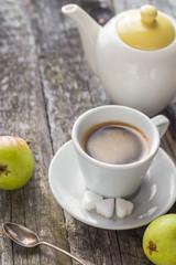 coffee cup black wooden board brown pears white jug