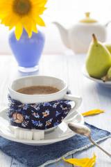 coffee cup black wooden board brown white jug milk sunflower pea