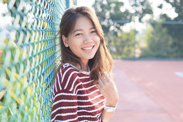 portrait of beautiful young woman toothy smiling with happy face