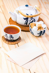 blank card and chinese set of tea