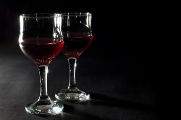 Two Glasses of Red Wine Isolated on Black Background