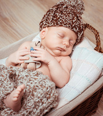 newborn boy  asleep in the basket