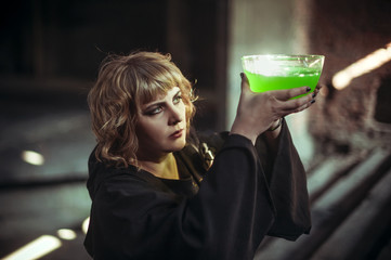 Young blond witch with poison in bowl
