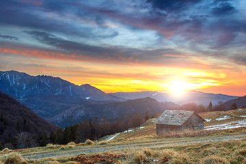 Ramshackle chalet and beautiful sunset,Ciucas,Romania